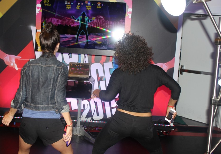 Just Dance Now. Notice the smartphone controllers.
