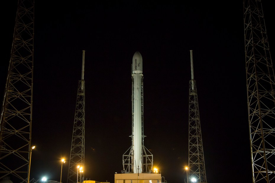 SpaceX moves its Falcon 9 reusable rocket into place in anticipation of its June 20 launch.