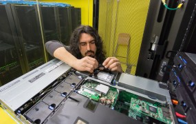 Man fixing server Federico Rostagno Shutterstock