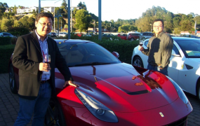 Game executives enjoying wine at a recent party at Ferrari showroom in Mill Valley.