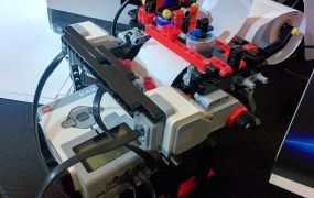 Braigo's Braille printer prototype includes Lego Mindstorms components as well as an Intel Edison chip.