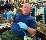 International Space Station commander Barry Wilmore  with a 3D-printed socket wrench made from a file NASA emailed into space.