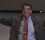 Tim Draper welcomes his students, in a promotional video.