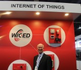 Scott McGregor, CEO of Broadcom, shows off gadgets for the Internet of Things at CES 2015.