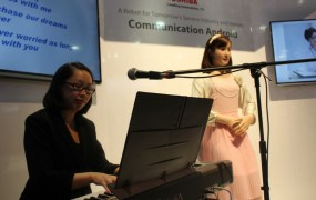 Which woman is real? ChihiraAico is a singing communications robot from Toshiba.