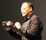 HTC Peter Chou holding the new HTC Vive virtual reality headset.