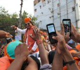 Crowds in Varanasi, India capture Bollywood actor Vivek Oberoi with their smartphones -- 2014.