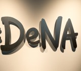 The DeNA logo, on the lobby wall of the company's Tokyo headquarters.