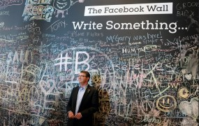 Defense Secretary Ashton Carter stands in front of the Facebook wall during his visit to the company's headquarters in Menlo Park, Calif., April 23, 2015. DoD photo by U.S. Army Sgt. 1st Class Clydell Kinchen