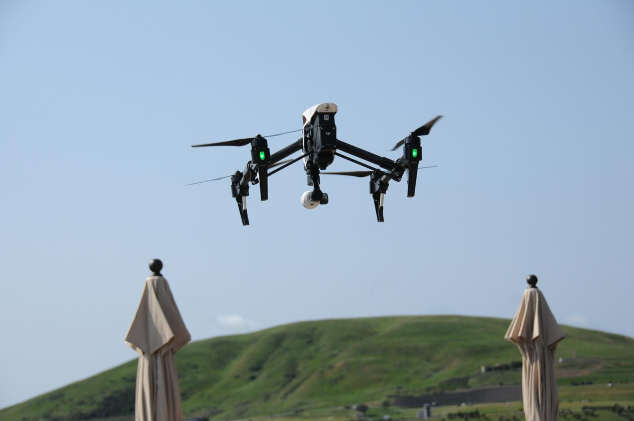 A DJI drone taking off.
