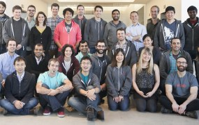 Airbnb's data science team. Riley Newman is fifth from right in the back row.
