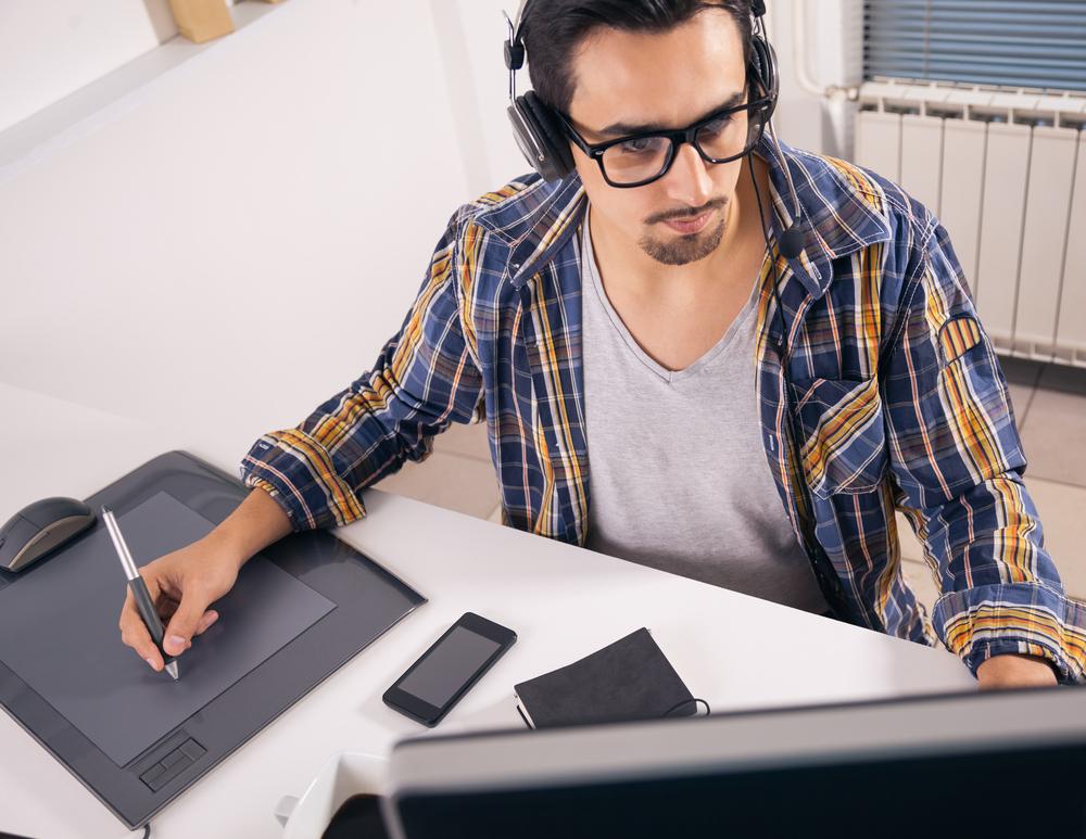 tech man at computer