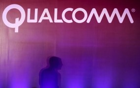A shadow is cast near a Qualcomm logo at the 2015 Computex exhibition in Taipei, Taiwan, June 2, 2015.