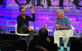 Twitter cofounder and board member Ev Williams speaking onstage with author Walter Isaacson.