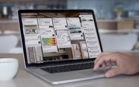 The Trello web app running on a MacBook.