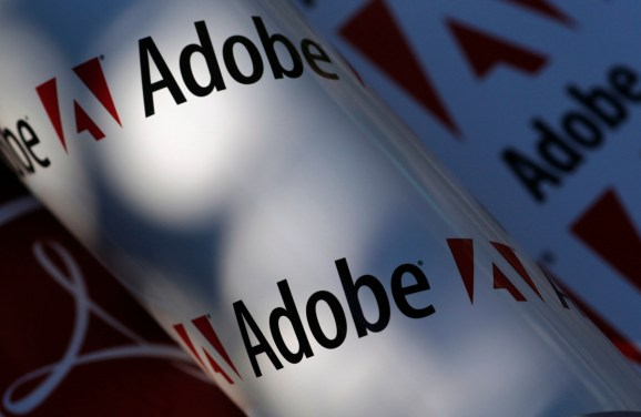 Adobe company logos are seen in this picture illustration taken in Vienna July 9, 2013. Picture taken July 9, 2013. To match Special Report TAX-BIGTECH/ REUTERS/Leonhard Foeger (AUSTRIA - Tags: BUSINESS SCIENCE TECHNOLOGY LOGO) - RTX11VPB
