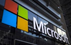 A Microsoft logo is seen on an office building in New York City, July 28, 2015. The global launch of the Microsoft Windows 10 operating system will take place on July 29.