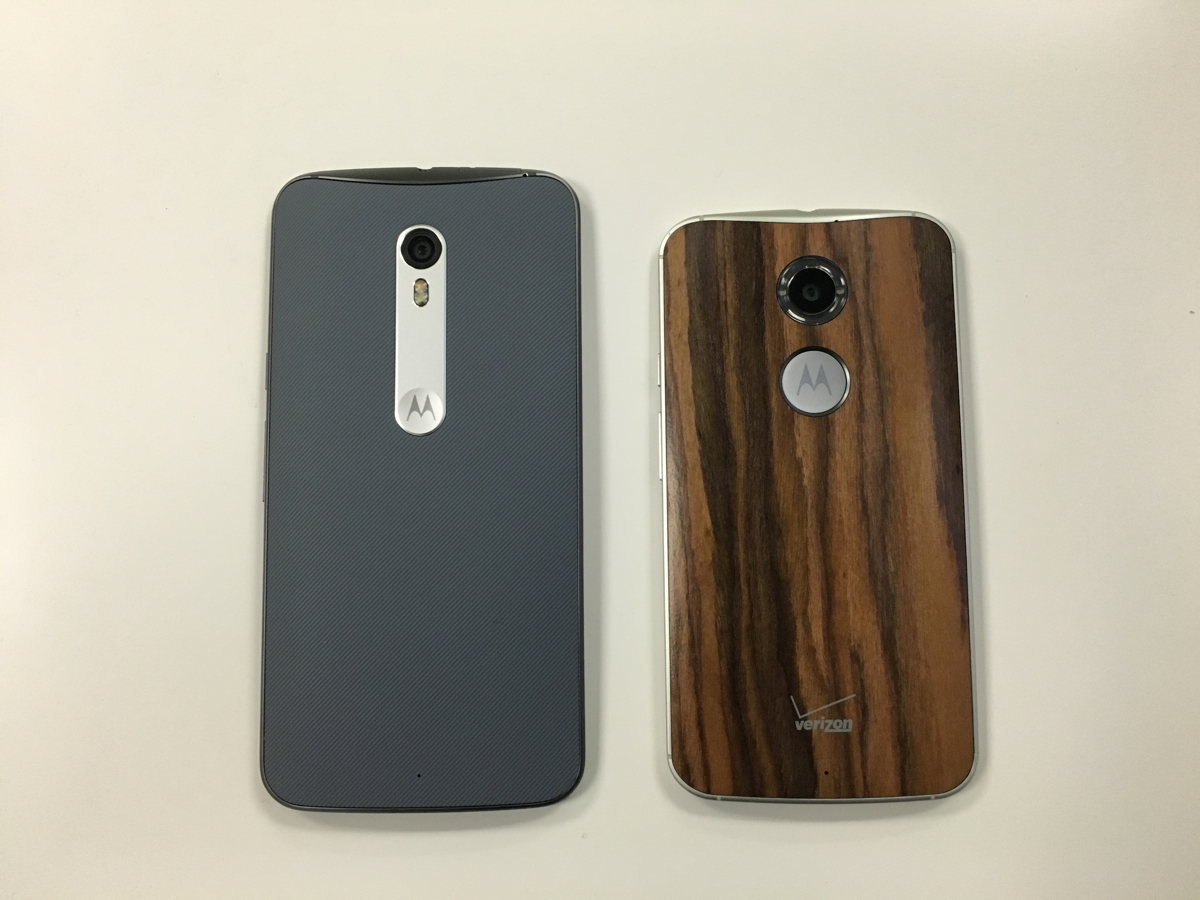 The back of the Moto X Pure Edition, left, next to the back of the Moto X (2nd Gen).