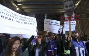 People protest in front of New York Attorney General Eric Schneiderman's office following his decision to shut down fantasy sports sites FanDuel and DraftKings, in the Manhattan borough of New York November 13, 2015.