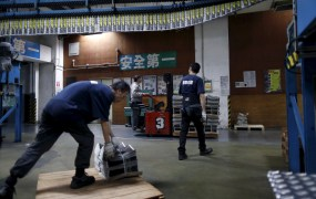 An employee operates a forklift to transport a pallet stacked with bundles of the Apple Daily newspaper, published by Next Media, at the company's printing facility in Hong Kong, China November 26, 2015.