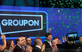 Employees and guests of Groupon ring the opening bell in celebration of the company's IPO at the Nasdaq Market in New York November 4, 2011.