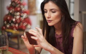 texting,christmas.shutterstock_102494720