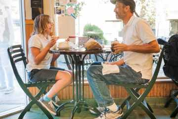 Sophie Thesen and family friend David Aziz enjoy bagels together.  The two often visit Izzy's Brooklyn Bagels to spend time together.