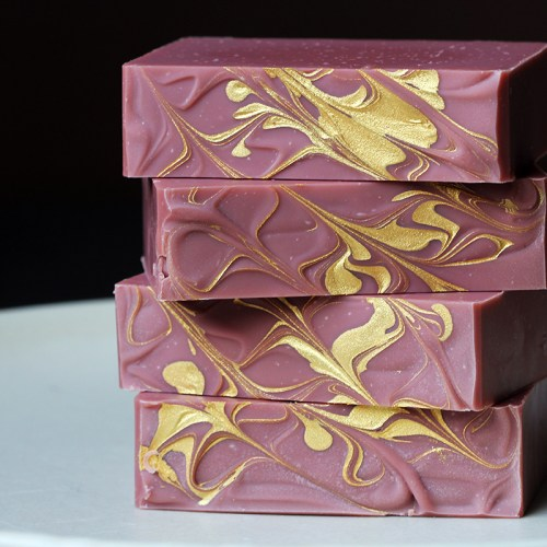 Tasmanian Soap, scented. Deep red colour, with gold swirling on top.