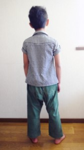 Checker print shirt and green sarouel