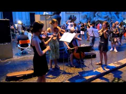 violinists-perform-pachabel-canon-in-d-major-in-fiumi-fountain-in-rome-italy25_thumbnail.jpg