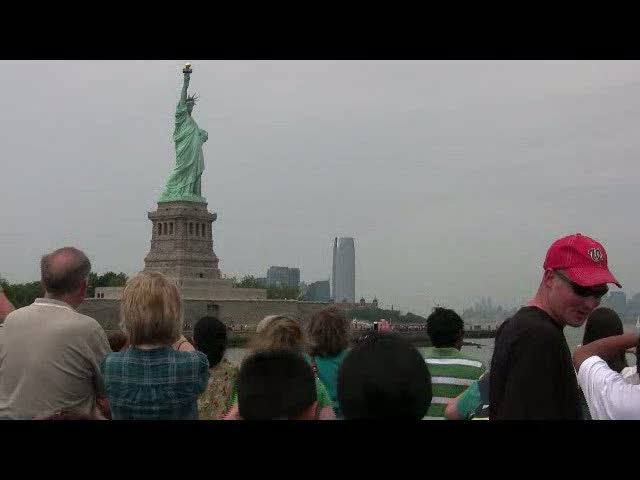Side view of the Statue of Liberty with NYC Skyline in the back