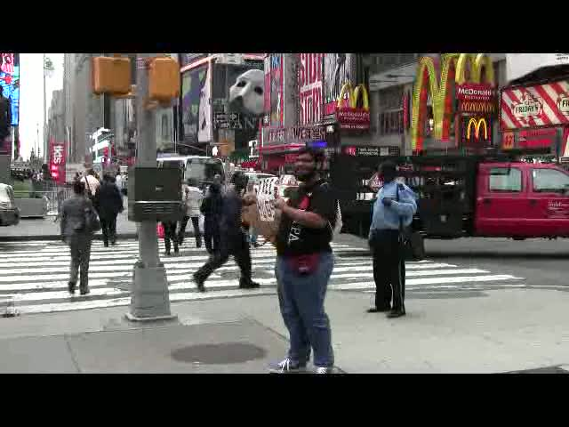 Victor giving hugs in Time Square