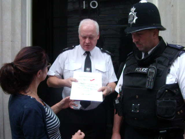 Sharon of C4T handing in file to Number 10.