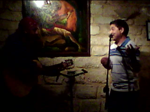 Resistencias open mic – with Roberto Arciniega on guitar and a Colombian singer.