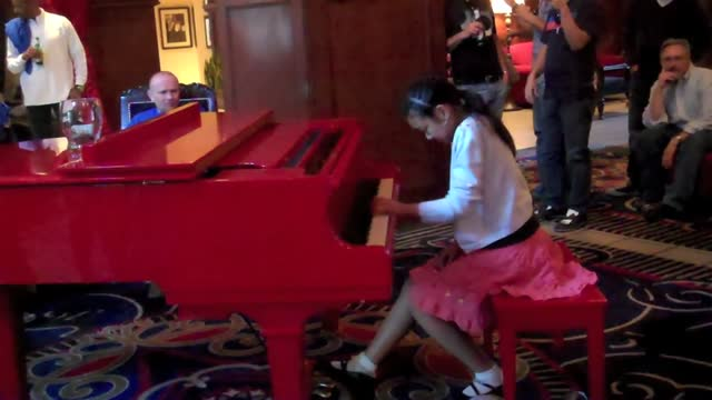 Victoria at the Red Piano
