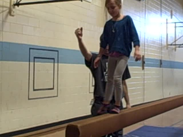 Nora on balance beam