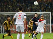 Timor Leste's Rodrigo Sousaor, far right, challenges for possession against Malaysia's Mohd Amri Yahyah, far left, during their Group A FIFA World Cup 2018 qualifying match against Malaysia in Kuala Lumpur, Malaysia on Thursday, June 11, 2015. (AP Photo/Joshua Paul)