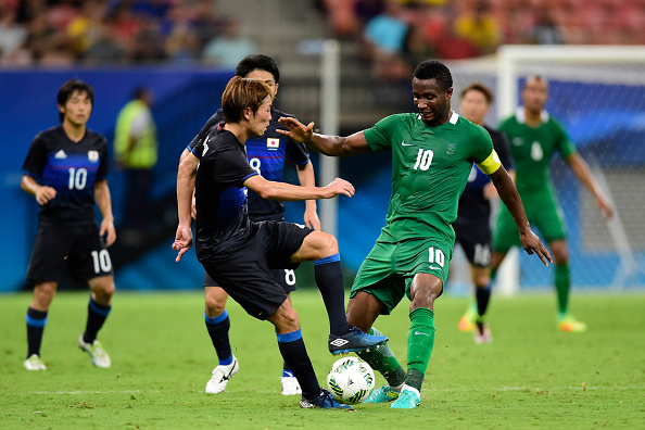 MANAUS, BRAZIL - AUGUST 04: Hiroki Fujharu player of Japan battles for the ball with John Obi Mikel player of Nigeria during 2016 Summer Olympics match between Japan and Nigeria  at Arena Amazonia on August 4, 2016 in Manaus, Brazil. (Photo by Bruno Zanardo/Getty Images)