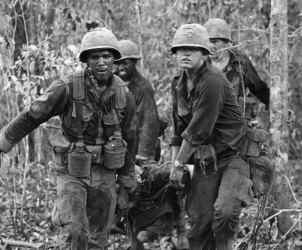 """WHEN Muhammad Ali said, """"I ain't got no quarrel with them Vietcong. No Vietcong ever called me nigger,"""" he spoke for many of the black soldiers and Marines who were in Vietnam fighting for an America that continued to oppress and marginalize them. One night in Chu Lai, I heard a black Marine say to a white one, """"Look, I don't want to hear 'gook' or 'dink' 'cause I don't know what you'll call me tomorrow.""""  I was in Vietnam — a reporter for the military newspaper Southern Cross — two years after Ali had been convicted of dodging the draft in the summer of '67. Thousands of black soldiers were fighting in Cu Chi, Phu Bai, Long Binh, Da Nang and hundreds of landing zones and firebases pockmarking South Vietnam, some wearing black unity wrist bands braided out of boot laces. Most received news of the civil rights movement — sit-ins, bombings, struggles with the police and dogs in the streets of cities and towns across America — in letters from home and in magazine headlines in those rare moments of stand-down at division headquarters.  Racial tension would often flare up in the rear. We knew the uniform or code of conduct couldn't erase what was in the hearts or on the lips of troops at the enlisted men's clubs where they guzzled 3.2 beer. Then the next day, the soldiers and Marines would plunge back into the leafy quagmire of the jungle or climb the bald hills of firebases for another deadly encounter with the Vietcong or North Vietnamese Army.  Ali was more than life-size in the psyche of the black soldier. Other conscientious objectors were in Canada or Sweden, but here stood a black man, the heavyweight champion of the world, saying, """"Why should they ask me to put on a uniform and go 10,000 miles from home and drop bombs and bullets on brown people in Vietnam while so-called Negro people in Louisville are treated like dogs and denied simple human rights?"""" Of course, some black soldiers knew this fueled North Vietnam's propaganda, and Hanoi Hannah's radio rants acros"""