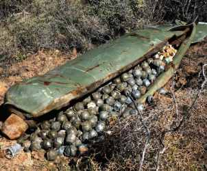 NOV. 9, 2006 FILE PICTURE ** FILE ** In this Nov. 9, 2006 file picture, a Cluster Bomb Unit containing more than 600 cluster bombs, that was dropped by Israeli warplanes during the 34-day long Hezbollah-Israeli war, sits in a field in the southern village of Ouazaiyeh, Lebanon. International diplomats from more than 100 nations reached agreement on a treaty that would ban current designs of cluster bombs and require the destruction of stockpiles within eight years. The breakthrough Wednesday May 28, 2008 capped more than a year of negotiations that began in Norway and concluded over the past 10 days in Dublin, but Israel did not participate in the treaty. (AP Photo/Mohammed Zaatari)