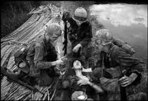VIETNAM. The battle for Saigon. American G.I's often showed compassion toward the Vietcong. This sprang from a soldierly admiration for their dedication and bravery; qualities difficult to discern in the average government soldier. This VC had fought for three days with his intestines in a cooking bowl strapped onto his stomach. 1968
