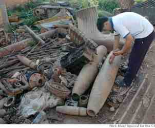 LAOS BOMBS_ph5.JPG Scrapyard in Xieng Khuang Province in Laos, including pile of bombs