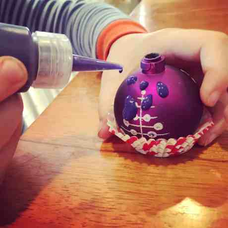 Homemade puff paint is the perfect boredom buster for kids of all ages! Combine a few simple pantry items to make this art + science fun! Glue small ornaments until a cupcake liner and use the puff paint to decorate your cupcake for a fun christmas decoration!