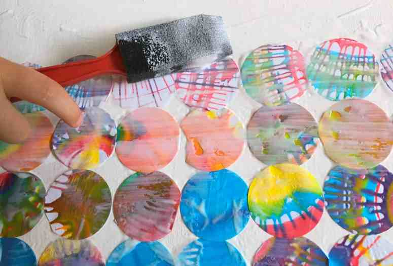 My kids love making spin art, but I'm always left wondering what to do with the finished products. Check out how we made beautiful spin art wall art!