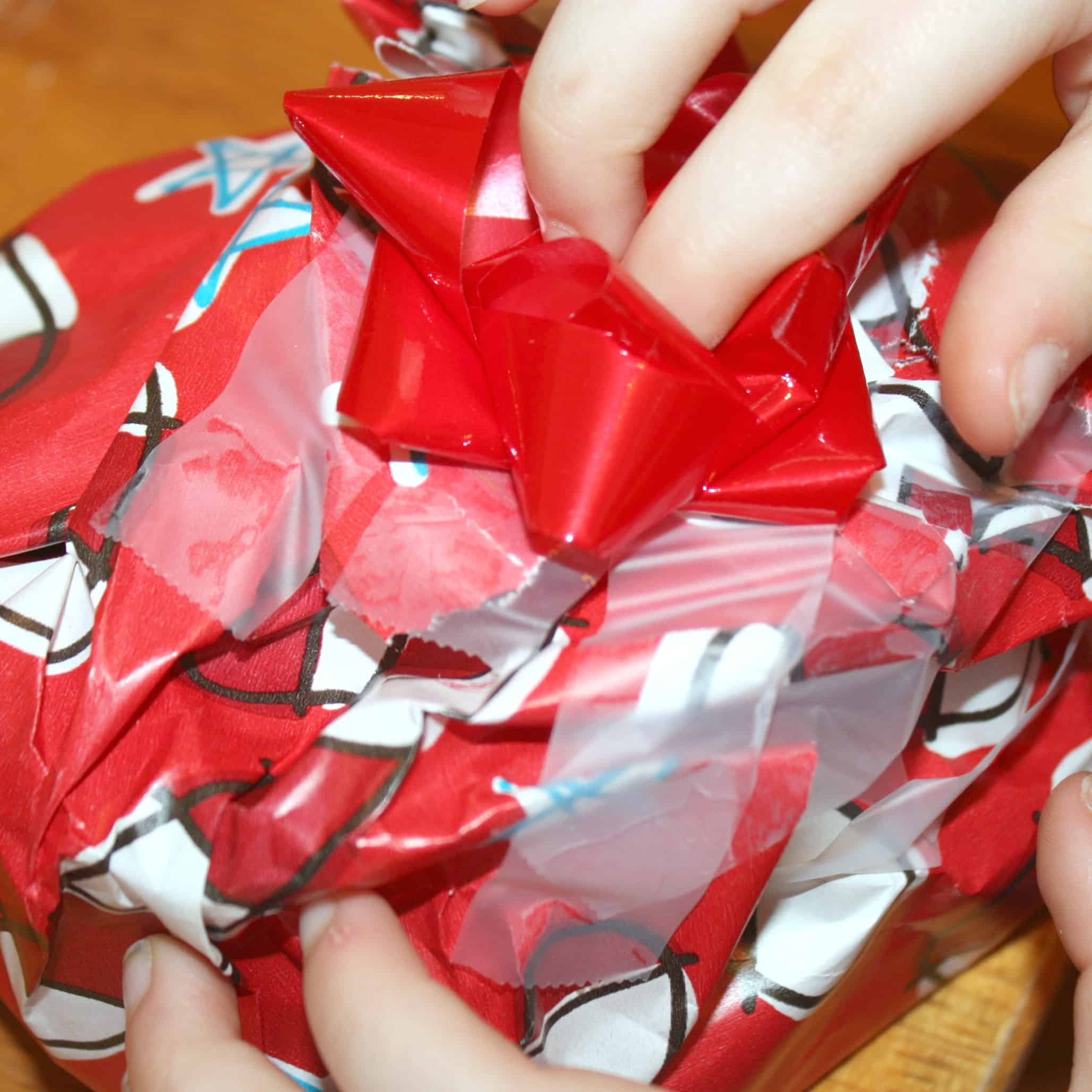 This fun gift wrapping pretend play activity is perfect for a seasonal project for toddlers through elementary aged children! Great for fine motor practice.