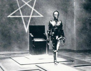 Maria from Metropolis with inverted pentagram behind her (symbol of Black Magic).