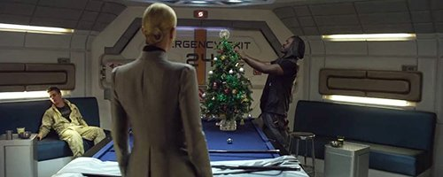 At the beginning of the trip, the Captain of the ship installs a Christmas tree but is ridiculed by his superior.