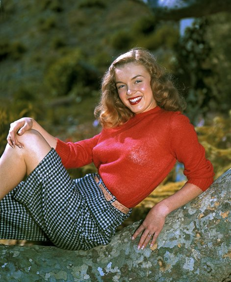 "When Norma Jeane was recruited as a model, she had curly red hair. This ""girl next door"" will soon get a ""Hollywood"" persona named Marilyn Monroe, with platinum-blonde hair."