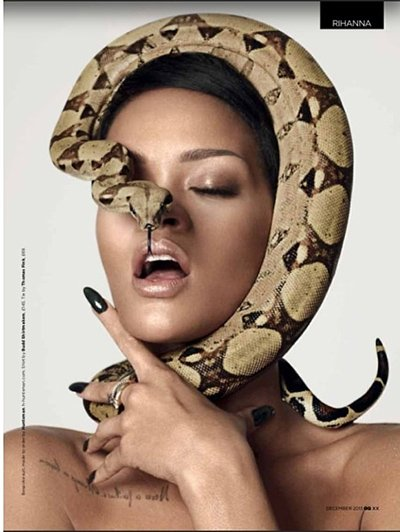 """In this pic, a snake almost strangles Rihanna while its head hides on of her eyes. Does this represent the """"stranglehold"""" the industry has on her and other Illuminati puppets?"""