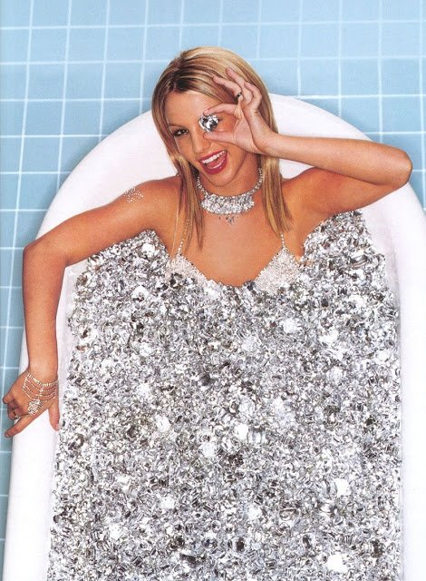 """Speaking of Kitten programming, here's a rare photo of Britney Spears from 2000. She is literally bathing in diamonds which is coincidentally the symbol used to indentify """"presidential models"""", the highest level of Kitten Programming. Of course, she is hidding one eye to make sure we understand what's going on there."""